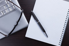 Blank notebook, pen, glasses and laptop Royalty Free Stock Photography