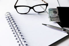 Blank notebook with pen and glasses Stock Image