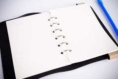 Blank notebook with pen Stock Photos