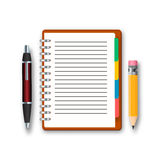 Blank notebook with pen and pencil isolated on a white background. Stock Images