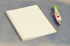 Blank notebook with pen and pencil on wooden table Royalty Free Stock Images