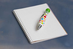 Blank notebook with pen and pencil on wooden table Stock Photos