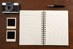 Blank notebook with pen, photo frames and camera Royalty Free Stock Images
