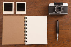 Blank notebook with pen, photo frames and camera Royalty Free Stock Photography