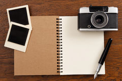 Blank notebook with pen, photo frames and camera Royalty Free Stock Photos