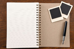 Blank notebook with pen and photo frames Stock Images