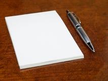 Blank notebook pen table Royalty Free Stock Photos