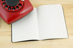 Blank notebook, pen and telephone Royalty Free Stock Photo
