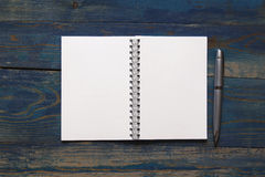 Blank notebook with pen on wooden desk Royalty Free Stock Image
