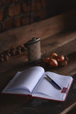 Blank notebook with pen on wooden table, business concept Royalty Free Stock Photos