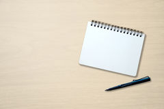 Blank notebook and pen on wooden table Royalty Free Stock Image