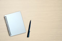Blank notebook and pen on wooden table Royalty Free Stock Photography