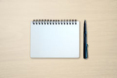 Blank notebook and pen on wooden table Stock Image