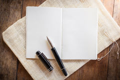 Blank notebook with pen Stock Images