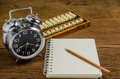 Blank notebook with pencil and abacus Stock Images