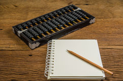 Blank notebook with pencil and abacus Royalty Free Stock Photos