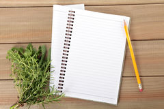 Blank notebook and pencil with a bunch of herbs Stock Photo