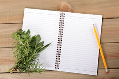 Blank notebook and pencil with a bunch of  herbs Stock Photos