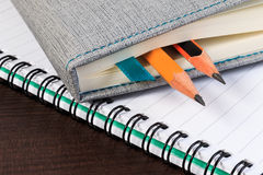 Blank notebook and pencil. Stock Image