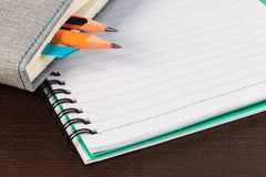 Blank notebook and pencil. Royalty Free Stock Photo