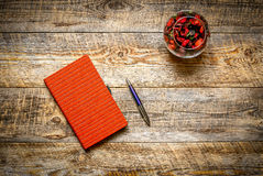 Blank notebook with pencil and  flower on vintage wooden table Stock Photos