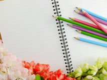 Blank notebook pencil and flowers with space copy background Stock Photo