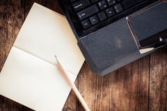 Blank notebook with pencil on Laptop Stock Photos