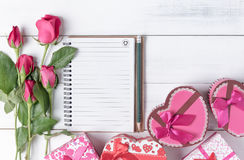 Blank notebook with pencil pink roses and heart gift box. Stock Photography