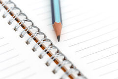 Blank notebook and pencil for text or background Stock Images