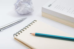 Blank notebook with pencil on white background.  Stock Photo