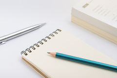 Blank notebook with pencil on white background Stock Images