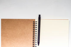 Blank notebook with pencil on white vintage background Stock Photo