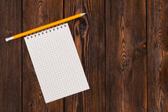 Blank notebook and pencil on a wooden background Royalty Free Stock Photo