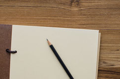 Blank notebook with pencil Stock Photo