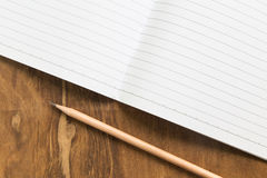 Blank notebook with pencil on wooden table, business concept Royalty Free Stock Images