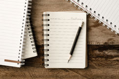 Blank notebook with pencil on wooden table - still life. Royalty Free Stock Photography