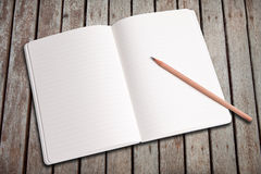 Blank notebook and pencil Royalty Free Stock Photos