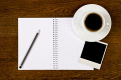 Blank notebook with photo frame and coffee cup Stock Images
