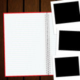 Blank notebook and photo on old wood background Royalty Free Stock Images