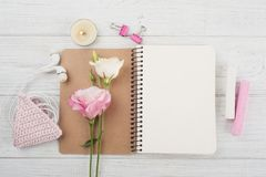 Blank notebook, pink crochet holdel, earphones Royalty Free Stock Photo