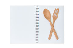 Blank notebook for recipe with wooden spoon and fork Royalty Free Stock Photo
