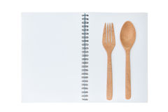 Blank notebook for recipe with wooden spoon and fork Stock Photos