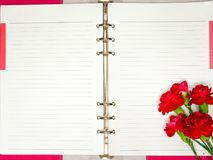 blank notebook and red flowers Stock Photos