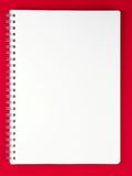 Blank notebook on red table. Stock Photos