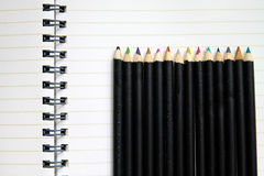 Blank notebook with row of crayon. Blank notebook with colorful row of crayon Royalty Free Stock Photos