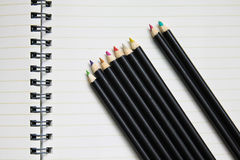 Blank notebook with row of crayon. Blank notebook with colorful row of crayon Stock Photo
