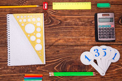 Blank notebook, ruler from the top, frame of school supplies ove Stock Images
