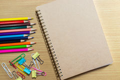 Blank notebook on school and frame of colorful school supplies a Stock Image