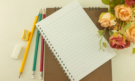 Blank notebook with  school supplies and rose, Vintage.  Royalty Free Stock Images