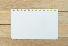Blank notebook sheet on wood background stock images